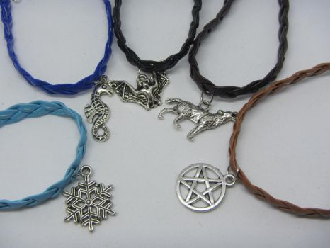 Bracelets of real leather and a charm. by IngaleCreations