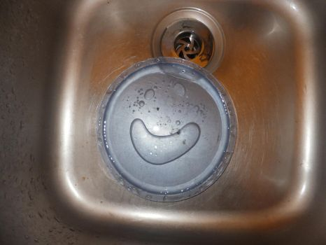 There's a Smiley-Face in my Sink! by Satans-Comrade