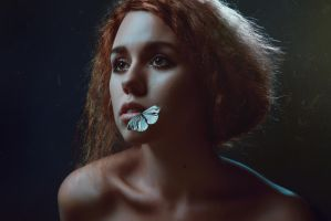Portrait of woman with white butterflies in studio by Black-Bl00d
