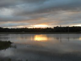 Evening sunset across the lake by knighttemplar1