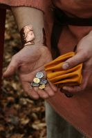 Coins in hand by Dewfooter