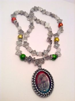 Art is Life rainbow silver beaded resin necklace by ArtAgainstSociety