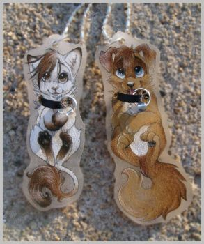 Leigh and Kyle necklaces by PixelRaccoon