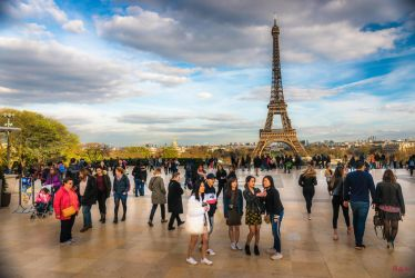 Paris the city of lights - tower and people by Rikitza