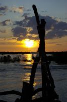 Sunset on the Mekong river by shkyo30