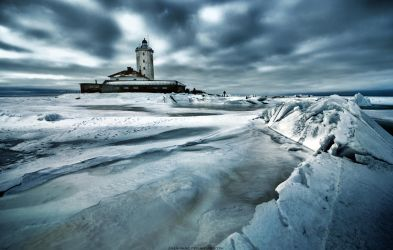 Frozen lighthouse by Zhen-Yang