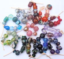 Rainbow of odd lampwork beads by fairyfrog