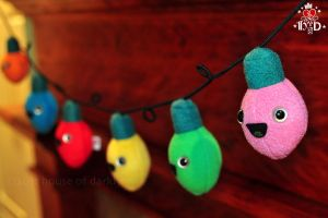 happy C7 bulbs plush Christmas light string by brokensymphony