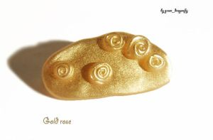 gold rose pin by dragonflyme