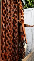 Rusty chain on truck by jeromy-huber