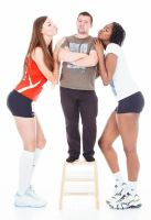 Two Tall women kiss short man by lowerrider
