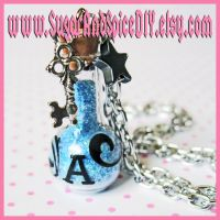 Drink Me Alice Bottle Necklace by wickedland