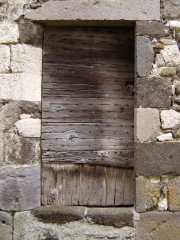 OLD WOOD DOOR IN LAVA WALL by isabelle13280