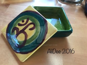 Painted, glazed pottery with Om by AliDee33