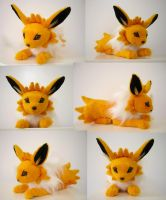 Laying Jolteon Plushie by SarityCreations