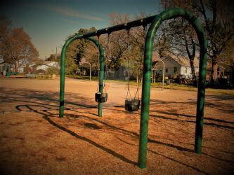 swings during the fall by rockenrobyn