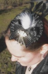 Black polka dot fascinator by fairyfrog