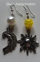 Mismatched sun_moon earrings by SilvieTepes
