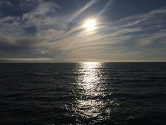 Afternoon Sun over the Pacific Coast by Mickeymcp