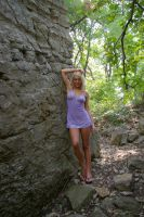 Girl Against Rock Wall 3 by candhphotography