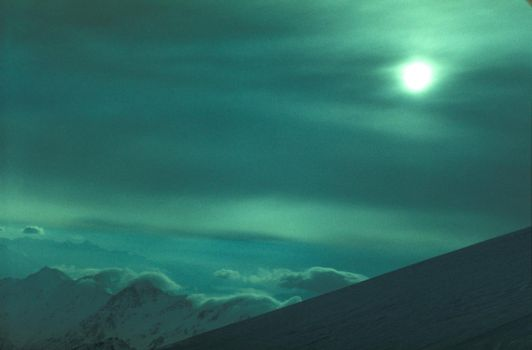 Moon above mountains by GiorR