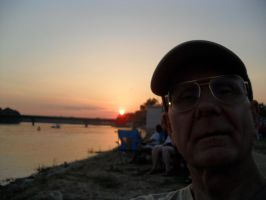 Cool Old Man by the river at sunset in Arkansas by caspercrafts