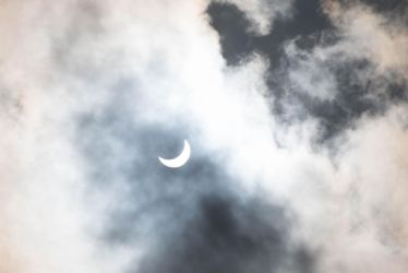 Cloudy eclipse by Ankh-Infinitus