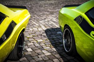 Old and new Dodge Challenger by AmericanMuscle