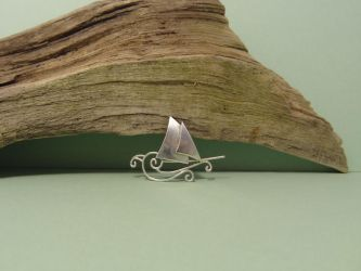 Swirling silver ship pendant by entanglement
