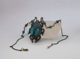 Steely Blue Scarab necklace by BringBackTheDodo