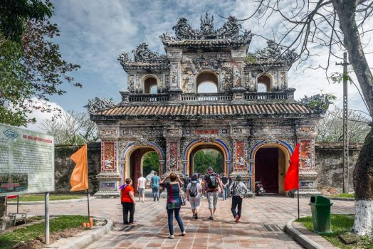 good morning Vietnam - tourists at the gate in Hue by Rikitza