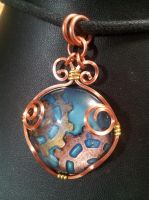 Enameled gears wrapped in square copper by BacktoEarthCreations