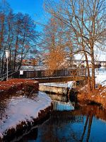 Bridge and river in winter scenery by patrickjobst