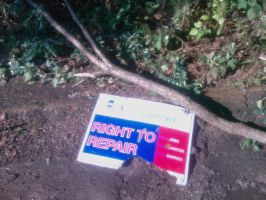 Right to repair, Weather beaten sign by caspercrafts