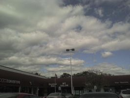 Clouds and a parking lot by OniRocu