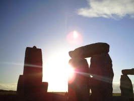 Stonehenge with Sun Behind by phoenixreal