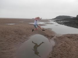 Leap over water by Cheshire-Maddie