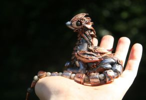 Issra - Steampunk silver and copper dragon by Akalewia