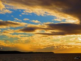 The Golden And Blue Cloudy Sky by wolfwings1