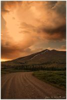 Rainy Sunset Over The Rockies by kkart