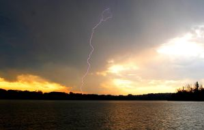 Lightning over the lake by OcularFracture