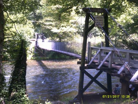 Footbridge over the Cheoah River in North Carolina by The-White-Tigress