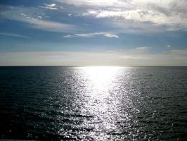 Sun touching the ocean by unitedcba