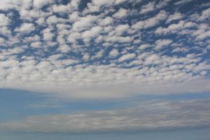 clouds along the beach by MorgaineA