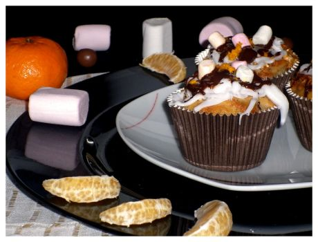 Orange/chocolate/marshmallow cupcakes home made by Younae
