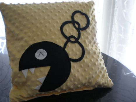 Yellow Chain Chomp Pillow by Omonomopoeia