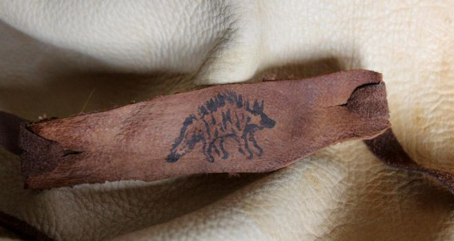 Hyena leather bracelet and more! by lupagreenwolf