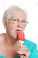5486142-senior-woman-licking-a-red-ice-cream by DoggoDoodler