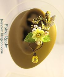 Lovely Fairy Sitting In The Yellow Garden Ear Cuff by woohoo80