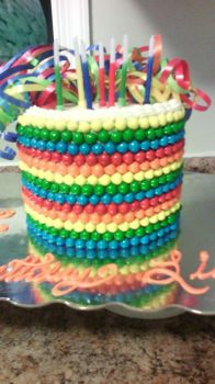Multi-colored Sixlet cake by euromuttgypsy